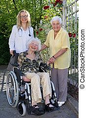 Doctor, Caregiver and Elderly Smiling at Camera