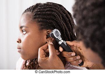 Doctor Checking Girl Ear In Hospital