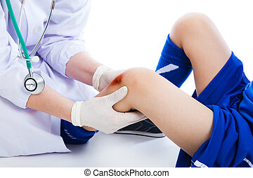 Doctor checking knee injury athlete, on white background. Studio shot