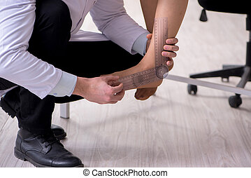 Doctor checking patients joint flexibility