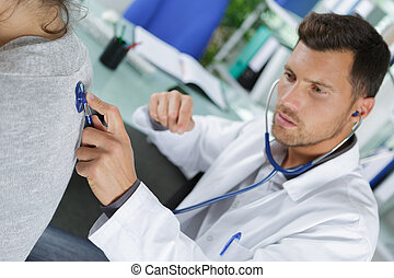 doctor checking the heart rate of a girl