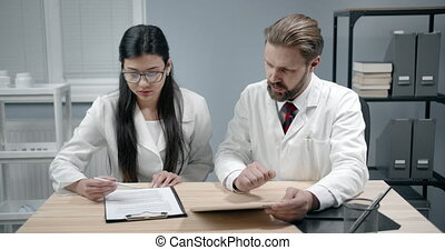 Doctor Colleagues Discussing Work