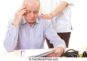 doctor comforting mature stressed patient