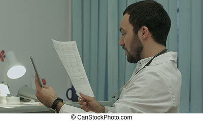 Doctor communicate by video conference on tablet pc, discuss documents