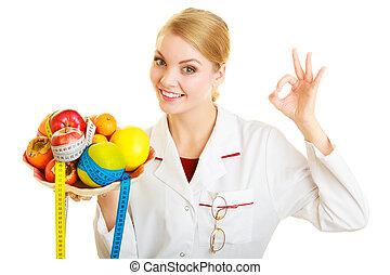 Doctor dietitian recommending healthy food. Diet. - Woman in...