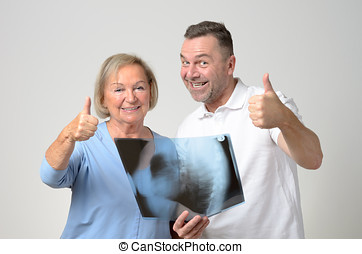 Doctor discussing an x-ray with a patient - Doctor...