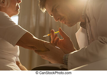 Doctor doing an injection