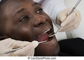 Doctor Doing Dental Check Up Of Patient
