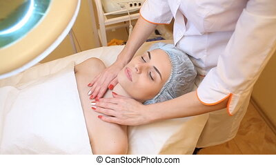 doctor doing massage beautician patient on the table