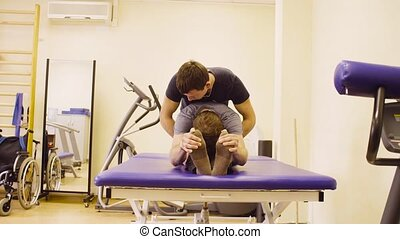 Doctor doing recovery exercises for disable man - Doctor...