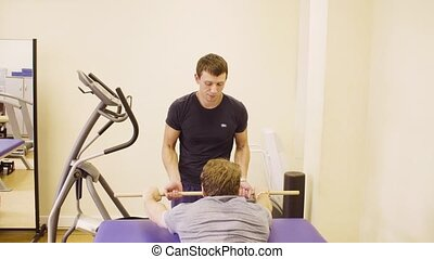Doctor doing recovery exercises for disabled man - Doctor...