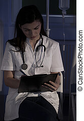 Doctor during night shift - Young pretty doctor during her ...