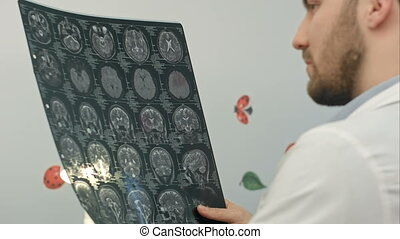 Doctor examines MRI image in hospital
