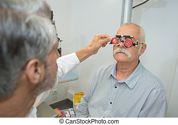 doctor examing senior male patient