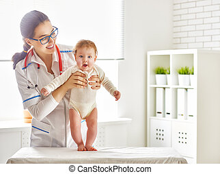 doctor examining a baby