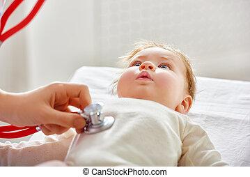 doctor examining a baby
