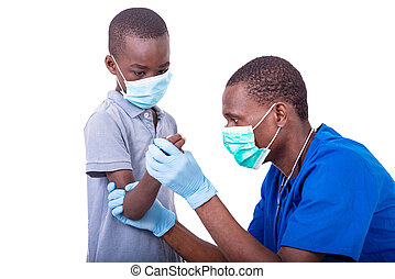 doctor examining a little boy.