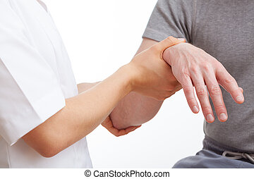 Doctor examining a patient - Doctor examining an aching hand