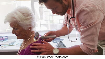 Doctor examining a senior woman in a retirement home