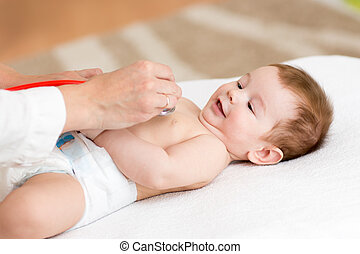 doctor examining baby with stethoscope