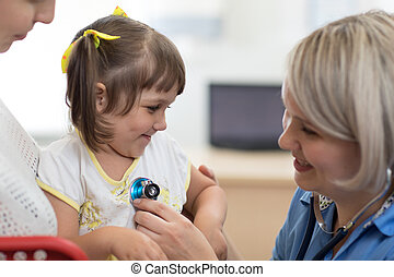 Doctor examining baby with stethoscope in clinic. Baby health concept