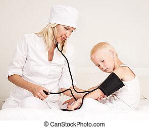 doctor examining blood pressure