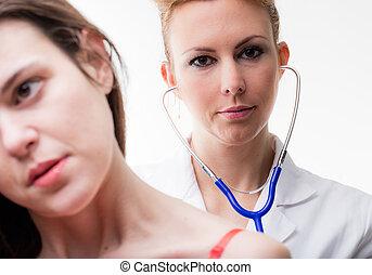 doctor examining her patient auscultating
