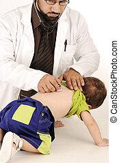 Doctor examining little baby boy