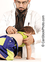 Doctor examining little baby boy