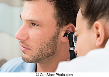 Doctor Examining Man's Ear