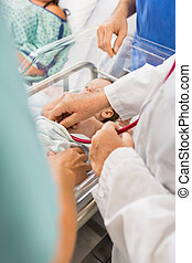 Doctor Examining Newborn Babygirl In Hospital - Cropped...