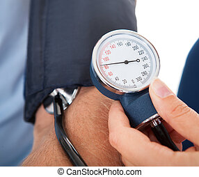 Doctor Examining Patient - Close-up of Doctor Checking Blood...