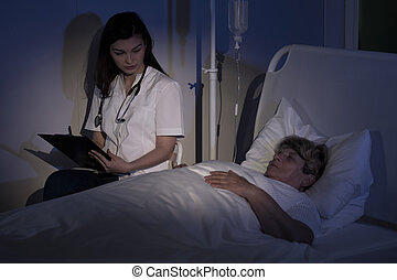 Doctor examining patient with tumor