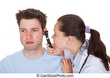Doctor Examining Patient's Ear