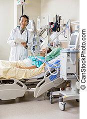 Doctor Examining Patient's Test Report On Digital Tablet -...