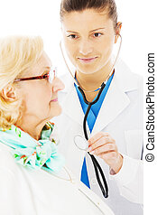 Doctor Examining Senior Woman With Stethoscope