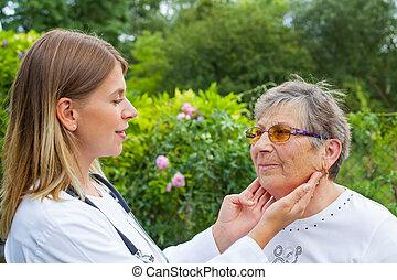 Doctor examining sore throat