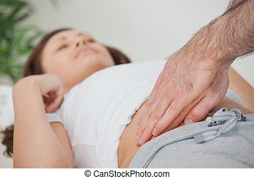 Doctor examining the stomach of his patient