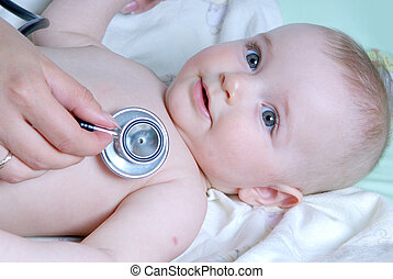 doctor exams baby with stethoscope