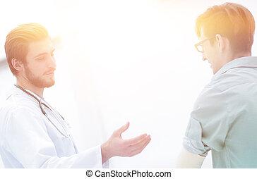 doctor explaining a patient