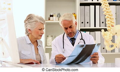 Doctor explaining a spine xray