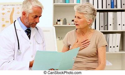 Doctor explaining an illness