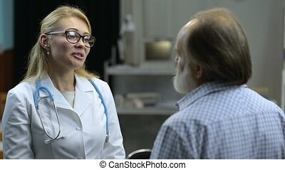 Doctor explaining good medical results to patient - Positive...