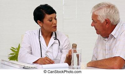 Doctor explaining medicine to patie