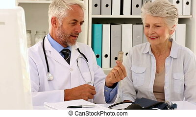 Doctor explaining prescription to h
