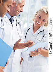 Doctor explaining something in his tablet