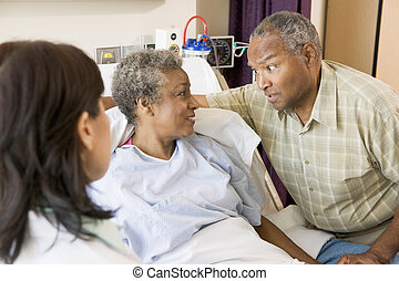 Doctor Explaining,Senior Couple Looking At Each Other