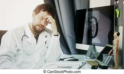 Doctor feeling tired with headache