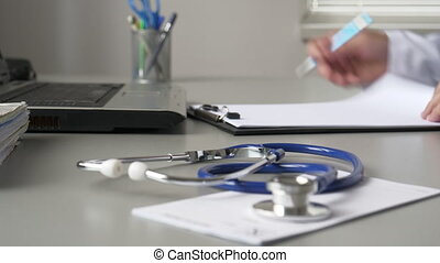Doctor Filling Out Medical Documents - Doctor in the...