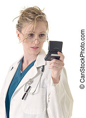 Doctor getting a 911 page - Attractive lady doctor reading...